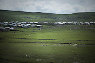 View for small settlement in Turkey build on the side of the road leading from Georgian-Turkish border crossing by Posof and leading to Kars.