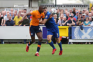 AFC Wimbledon defender Jon Meades (3) battles for possession with Oldham Athletic midfielder Ousmane Fane (24) during the EFL Sky Bet League 1 match between AFC Wimbledon and Oldham Athletic at the Cherry Red Records Stadium, Kingston, England on 21 April 2018. Picture by Matthew Redman.