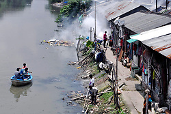 August 9, 2017 - Kolkata, West Bengal, India - Municipal workers spray chemicals in canal and other worker fumigate slum area to kill mosquito in Kolkata. Municipal workers fumigate slum area beside Kestopur canal as a precaution measure against mosquito born diseases like dengue and malaria on August 9, 2017 in Kolkata. (Credit Image: © Saikat Paul/Pacific Press via ZUMA Wire)