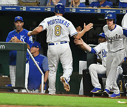 May 18, 2018 - Kansas City, Missouri, U.S. - KANSAS Kansas City, MO - MAY 18:  teammates greet Kansas City Royals third baseman Mike Moustakas (8) in the dugout after he scored in the seventh inning during a Major League Baseball game between the New York Yankees and the Kansas City Royals on May 18, 2018, at Kauffman Stadium, Kansas City, MO. Kansas City won, 5-2.  (Photo by Keith Gillett/Icon Sportswire) (Credit Image: © Keith Gillett/Icon SMI via ZUMA Press)