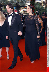 © Arnal-Hahn-Nebinger/ABACA. 45645-47. Cannes-France, 15/05/2003. Cast members Carrie-Anne Moss and Keanu Reeves arrive at the screening of the film Matrix Reloaded in the Palais des Festivals as part of the 56th Cannes Film Festival.  Cannes Film Festival Festival de Cannes Festival du Film de Cannes Cannes Film Festival Matrix Reloaded Matrix 2 The Matrix Reloaded Moss Carrie-Anne Moss Carrie-Anne Reeves Keanu Reeves Keanu Montee des marches Tapis rouge Red carpet Presentation de film Presentation de serie Movie Screening<br /> Photocall<br /> Photo call Soiree Party Cannes France Frankreich Provence-Alpes-Côte d'Azur Provence-Alpes-Cote d'Azur En pied Full length Vertical Vertical  | 45645_47