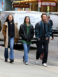 """Jude Law sports a fuller hairline while filming with costars Raffey Cassidy and Stacy Martin on the set of """"Vox Lux"""" in Midtown Manhattan. Raffey Cassidy will be playing a younger version of Natalie Portman who is set to play the lead role in the film. 12 Feb 2018 Pictured: Jude Law, Raffey Cassidy, Stacy Martin. Photo credit: LRNYC / MEGA TheMegaAgency.com +1 888 505 6342"""