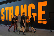 The word Strange is written in large orange lettering as part of Strange Days, an video arts exhibition, on 3rd October 2018, in London, England. Strange Days: Memories of the Future, is a new exhibition presented by New York's New Museum and The Store X in partnership with The Vinyl Factory, at London's The Store X, 180 The Strand. The Massimiliano Gioni-curated exhibition features work by some of the world's most exciting film-makers and video artists, presented as large-scale, multi-screen video installations, many of which are being shown in the UK for the first time.