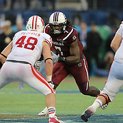 South Carolina Gamecocks defensive end Jadeveon Clowney (7) plays against Wisconsin Badgers tight end Jacob Pedersen (48) during the NCAA Capital One Bowl football game between the South Carolina Gamecocks who represent the SEC and the Wisconsin Badgers who represent the Big 10 Conference, at the Florida Citrus Bowl on Wednesday, January 1, 2014 in Orlando, Florida. (AP Photo/Alex Menendez)