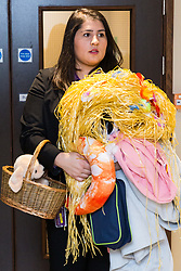 Assistant Manager Bruna Salvadori takes an armful of lost property to the store room. London, July 24 2019.