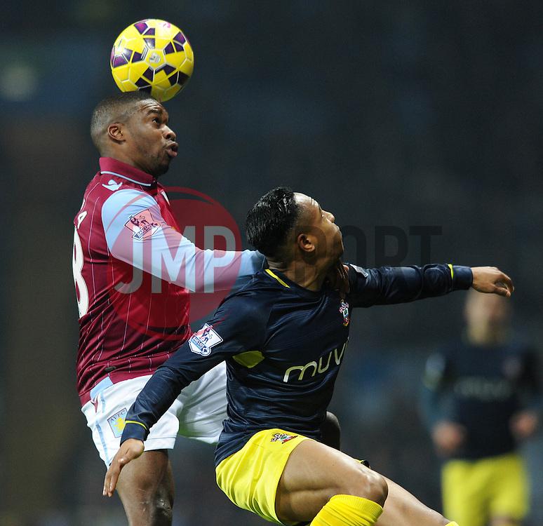 Aston Villa's Charles N'Zogbia beats Southampton's Nathaniel Clyne to the ball - Photo mandatory by-line: Dougie Allward/JMP - Mobile: 07966 386802 - 24/11/2014 - SPORT - Football - Birmingham - Villa Park - Aston Villa v Southampton - Barclays Premier League