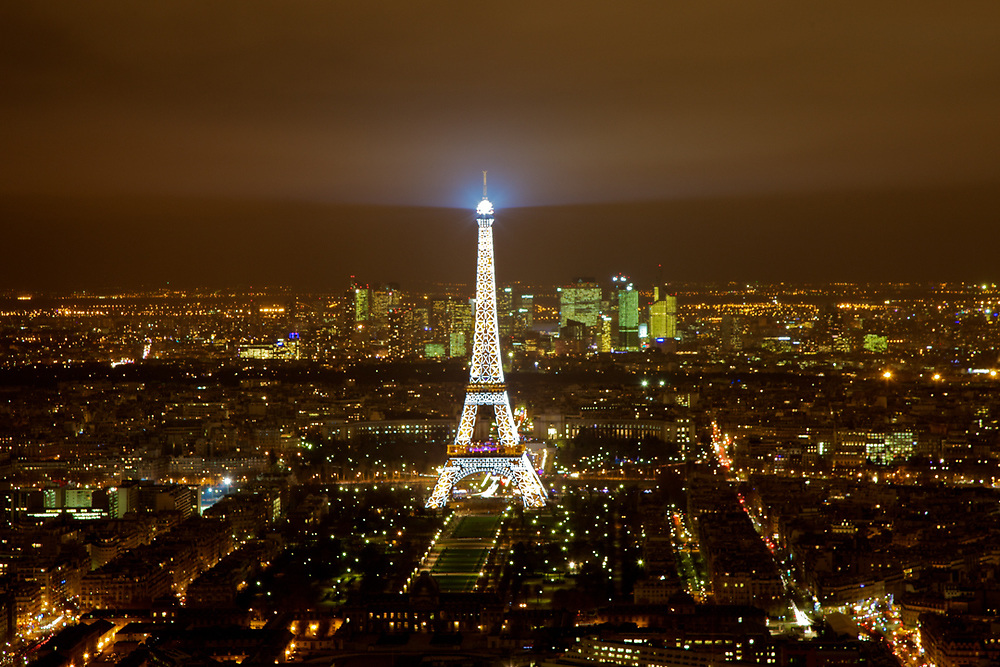 A classic night view of the Tour Eiffelle from Mount Parnasse Tower in Paris.<br /> Photo by Lorenz Berna