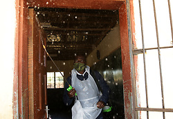 South Africa -Durban 29 MAY 2020 -Coronavirus :Bongani Mngwengwe  sanitises desks at Ingcindezi primary school KwaXimba before the reopening of schools in the country <br /> Picture :Bongani Mbatha/ Africa News Agency (ANA)