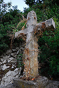Stone cross decorated with dried plants, Racisce, island of Korcula, Croatia