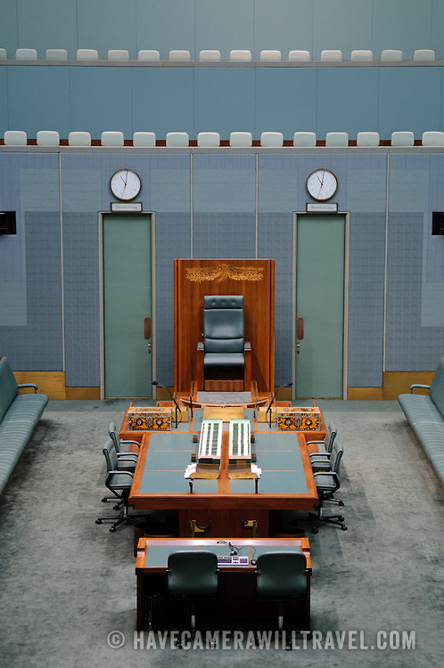 """In a reflection of the colour scheme of the British House of Commons, the House of Representatives is decorated in green. However, the colour is muted to suggest the colour of eucalyptus leaves.Parliament House is the meeting place of the Parliament of Australia. It is located in Canberra, the capital of Australia. It was opened on 9 May 1988 by Queen Elizabeth II, Queen of Australia.[1] Its construction cost was over $1.1 billion. At the time of its construction it was the most expensive building in the Southern Hemisphere. Prior to 1988, the Parliament of Australia met in the Provisional Parliament House, which is now known as """"Old Parliament House""""."""
