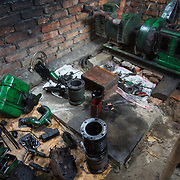 CAPTION: Since one of DESI Power's customers switched from diesel to biomass to fuel his business, this diesel engine has been stripped down to its component parts. LOCATION: Gayari, Araria District, Bihar, India. INDIVIDUAL(S) PHOTOGRAPHED: N/A.