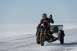 Dmitrii Obrazumov on his Muravey scooter trike in the Baikal Mile Ice Speed Festival. Maksimiha, Siberia, Russia. Friday, February 28, 2020. Photography ©2020 Michael Lichter.