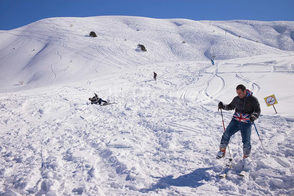 Skiers learning to ski in the fresh snow at Beldersay ski resort on 27th February 2014 in Uzbekistan.