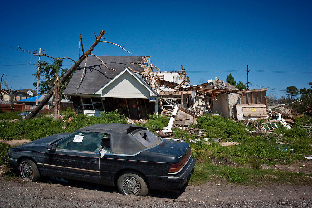 An abandoned home in the Lakeview area that was hit by a tornado after already suffering major damage due to Hurricane Katrina flooding in New Orleans, Louisiana. Many of these homes' interiors like this one remain untouched; floors are covered in flood debris and rubble while the walls and surfaces are still scab-covered layers of mold.