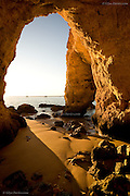Fantastic caves and rock formations at the coast at Praia do Pintadinho near Ferragudo, Algarve, Portugal.