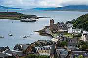 Oban Bay and ferry seen from McCaig's Tower viewpoint. Oban is an important tourism hub and Caledonian MacBrayne (Calmac) ferry port, protected by the island of Kerrera and Isle of Mull, in the Firth of Lorn, Scotland, United Kingdom, Europe.
