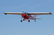 Middletown, New York - A single-engine airplane flies over Randall Airport on April 12, 2014. ©Tom Bushey / The Image Works
