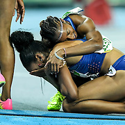 United States hurdler Brianna Rollins hugged her teammate, Kristi Castlin, after Rollins won gold and Castlin won bronze in the women's 100m hurdles final on Thursday at Olympic Stadium during the 2016 Summer Olympics Games in Rio de Janeiro, Brazil.