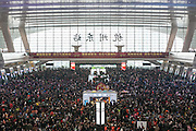 SHANGHAI, CHINA - FEBRUARY 01: (CHINA OUT) <br /> <br /> 100,000 travellers left stranded at a Chinese train station amid holiday rush<br /> <br /> More than 100,000 travellers were left stranded outside a train station in China last night as trains were delayed due to heavy snow.<br /> <br /> Passengers who were preparing to make their way home for the upcoming New Year celebrations were left queuing outside Guangzhou Railway Station in freezing conditions, reports the People's Daily Online.<br /> <br /> Throughout the day huge queues developed outside the station, and some passengers waited up to ten hours before they could catch their train home. At least 32 trains were delayed in Guangzhou last night alone. <br /> Pictures of the mad rush and busy queues have been circulating on Chinese media, showing a sea of people waiting outside patiently to get into the station and onto a train.<br /> <br /> Though some looked calm, most of the passengers looked stressed out and tired after waiting for such a long time, frustrated that their trains were delayed. <br /> <br /> As thousands of people waited outside in freezing temperatures yesterday, some fortunate passengers managed to travel. A total of 174,000 passengers were successfully transported at Guangzhou Railway Station, and 146,000 passengers at the Guangzhou East Railway Station.<br /> <br /> Chinese New Year - also referred to as the annual Spring Festival - falls on February 8, and holiday celebrations can last a full month. <br /> <br /> A whopping 2.91 billion journeys are expected to occur over the festival period this year from January 24 until March 3 as millions of migrant workers head home to their families then return to cities to work.<br /> <br /> According to the report, the railway department has warned passengers not to arrive at the train stations too early during the Spring Festival travel period, as it only creates a crush and can cause delays.<br /> ©Exclusivepix Media