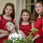 A flower girl and junior bridesmaids look for the bride before a wedding ceremony on Jekyll Island. ©Travis Bell Photography