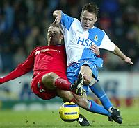 Fotball<br /> Premier League England 2004/2005<br /> 21.11.2004<br /> Foto: SBI/Digitalsport<br /> NORWAY ONLY<br /> <br /> Blackburn v Birmingham<br /> Barclays Premiership. 21/11/2004. <br /> <br /> Paul Dickov of Blackburn Rovers tangles with Kenny Cunningham of Birmingham City in the lead-up to Blackburns equalising goal.