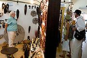 Customers browse in the main shop of the Village Artisanal de Ouagadougou, a cooperative that employs dozens of artisans who work in different mediums, in Ouagadougou, Burkina Faso, on Monday November 3, 2008.