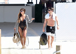 *PREMIUM EXCLUSIVE* Real Housewife of New Jersey Teresa Giudice hits the beach with hunky young companion Blake Schreck. The pair lazed on loungers at a South Beach, Miami, hotel, and later shared a bottle of rose wine over lunch inside the hotel. Teresa, 46, is reported to have become close friends with the young beau while husband of nearly 20 years, Joe, serves a 41-month prison sentence for mail, wire, and bankruptcy fraud, before being deported to his native Italy. Meanwhile, it seems the mother of his four daughters is moving on with her life. On Saturday, Teresa and Blake, who's 26 yrs old, met up at the swanky Coral Gables Country Club and left with friends at about 11.30pm. Teresa showed off her fabulous figure in a full-length and strapless black evening gown, while Blake wore a back shirt and matching bow tie, black pants, red suspenders, and loafers.They hopped out of the car close to the SLS LUX hotel in the Brickell business district, and disappeared inside. Thirty minutes later, they re-emerged, jumped into an Uber and sped off towards a rented condo, where Teresa and her party have been staying. She instagrammed a photo of herself at the condo's rooftop pool. The previous day, Teresa looked amazing in a plunging one-piece swimsuit as she strolled along the shore at South Beach in the blazing sunshine. News of her friendship with Blake comes as she prepares to reunite with her Jersey co-stars for the long-awaited Season 9 reunion, later this month, where she is expected be clash with co-star Jackie Goldschneider. Meanwhile, Joe languishes at Federal Correctional Institution, Allenwood, Pennsylvania, awaiting deportation. The couple made headlines in 2014 after they pleaded guilty to 41 counts of fraud. Joe had also confessed that he owed more than $200,000 in taxes. Teresa served a little over 11 months in prison and was released on Dec. 23, 2015. She's since been caring for the couple's four daughters: Gia, 18, Gabriella, 15, Milania, 14, and