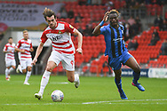 John Marquis of Doncaster Rovers (9) gets past Gabriel Zakuani of Gillingham (6) during the EFL Sky Bet League 1 match between Doncaster Rovers and Gillingham at the Keepmoat Stadium, Doncaster, England on 20 October 2018.