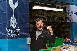 Market trader Sam Grainger, 24, shows his loyalty to Spurs at Hall's Greengrocers in Holcombe market ahead of Tottenham's Champions League final with Liverpool to be played at Atletico Madrid's Wanda Metropolitano Stadium in Madrid. Tottenham, London, May 31 2019.
