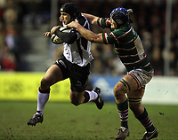 Photo: Rich Eaton.<br /> <br /> Leicester Tigers v Newcastle Falcons. Guinness Premiership. 27/01/2007. Mark Mayerhofler of Falcons is tackled by Leicesters Jordan Crane
