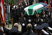 The Coffin of Police Officer Omar Edwards at the funeral for NYPD Officer Omar Edwards held at Our Lady of Victory in Brooklyn on June 4, 2009..NYPD Officer Omar Edwards posthumusly promoted to the rank of Detective was killed by NYPD Detective Andrew Dunton in a case of friendly fire, when Edwards was takened for a suspect with gun in hand. On Thursday June 4 2009, Officer Omar J. Edwards, 25, was shot by a fellow officer on a Harlem street while in street clothes. He had just finished his shift, and had his service weapon out, chasing a man who had broken into his car, police said. Three plainclothes officers on routine patrol arrived at the scene and yelled for the two to stop, police said. One officer, Andrew Dunton, opened fire and hit Edwards three times as he turned toward them with his service weapon. It wasn't until medical workers were on scene that it was determined he was a police officer.