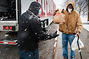 23 NOVEMBER 2020 - DES MOINES, IOWA: during a Thanksgiving food distribution at a park in Des Moines during a snowstorm. The food distribution was organized by Urban Dreams, a community empowerment NGO in central Des Moines, and the NAACP. The food was provided by Hy-Vee, a regional grocery store chain based in Des Moines. They had about 450 meals available. A spokesperson for Hy-Vee said the company was giving away more than 20,000 Thanksgiving meals this year. The Food Bank of Iowa said food insecurity in Des Moines has doubled since the start of the Coronavirus pandemic.   PHOTO BY JACK KURTZ