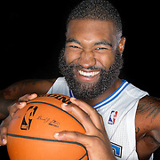 Kyle O'Quinn poses in front of a backdrop during the Orlando Magic media day event at the Amway Arena on Monday, September 30, 2103 in Orlando, Florida. (AP Photo/Alex Menendez)