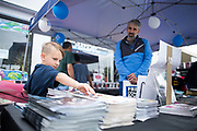 Tuulia Read, 6, snags a free comic book with his dad Simon Read of Santa Clara during Free Comic Book Day at Black Cat Comics in Milpitas, California, on May 6, 2017. (Stan Olszewski/SOSKIphoto)