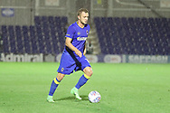 AFC Wimbledon midfielder Dean Parrett (18) dribbling in the rain during the Pre-Season Friendly match between AFC Wimbledon and Burton Albion at the Cherry Red Records Stadium, Kingston, England on 21 July 2017. Photo by Matthew Redman.