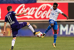 (L-R) Alexandru Chipciu of RSC Anderlecht, Moses Daddy Ajala Simon of KAA Gent during the Jupiler Pro League match between KAA Gent and RSC Andelecht at the Ghalemco Arena on August 27, 2017 in Gent, Belgium