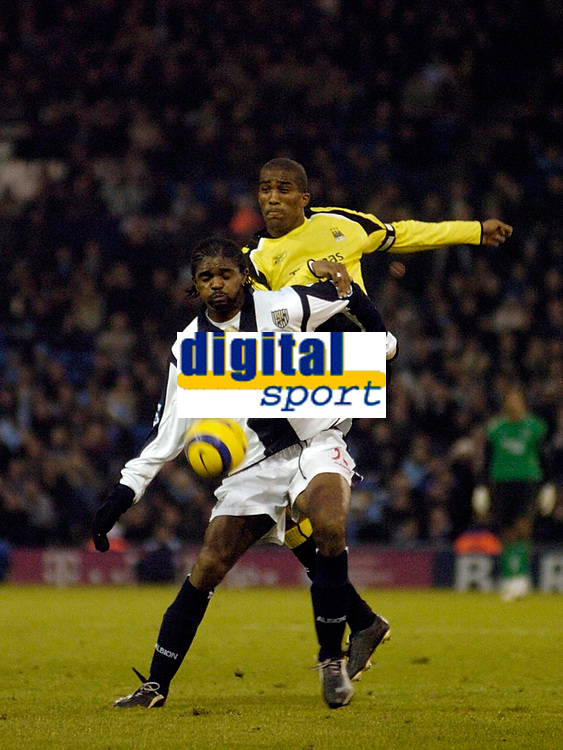 Photo: Leigh Quinnell.<br /> West Bromwich Albion v Manchester City. The Barclays Premiership. 10/12/2005. West Broms Nwankwo Kanu comes under attack from Man Citys Sylvain Distin.