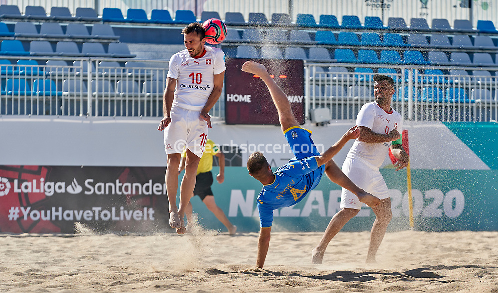 NAZARE, PORTUGAL - SEPTEMBER 4: Kostiantyn Makeiev of Ukraine and Noel Ott of Switzerland during day 3 of the Euro Beach Soccer League Superfinal at Estadio do Viveiro on September 4, 2020 in Nazare, Portugal. (Photo by Jose Manuel Alvarez/BSWW)