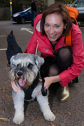 Hampstead Heath, London, October 26th 2014. Dogs rescue and re-homing charity All Dogs Matter hold their annual Halloween fancy dress dog walk on Hampstead heath. PICTURED: Jodie with her miniature Schauser, Dave.