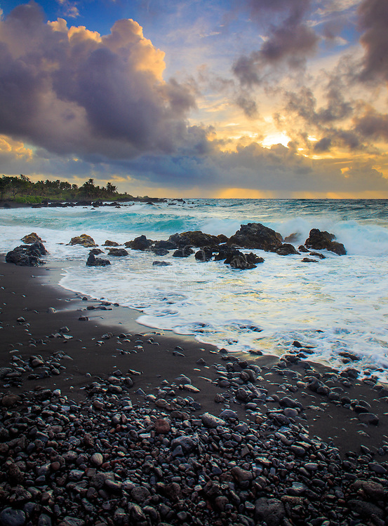 "Dramatic sunrise over Hana Bay on the northeast coast of Maui, Hawaii, in the town of Hana<br /> .....<br /> The island of Maui is the second-largest of the Hawaiian Islands and is the 17th largest island in the United States. Maui is part of the State of Hawaii and is the largest of Maui County's four islands, bigger than Molokaʻi, Lānaʻi, and unpopulated Kahoʻolawe. Native Hawaiian tradition gives the origin of the island's name in the legend of Hawaiʻiloa, the navigator credited with discovery of the Hawaiian Islands. According to that legend, Hawaiʻiloa named the island of Maui after his son, who in turn was named for the demigod Māui. The earlier name of Maui was ʻIhikapalaumaewa. The Island of Maui is also called the ""Valley Isle"" for the large isthmus between its northwestern and southeastern volcanoes and the numerous large valleys carved into both mountains."