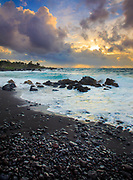 """Dramatic sunrise over Hana Bay on the northeast coast of Maui, Hawaii, in the town of Hana<br /> .....<br /> The island of Maui is the second-largest of the Hawaiian Islands and is the 17th largest island in the United States. Maui is part of the State of Hawaii and is the largest of Maui County's four islands, bigger than Molokaʻi, Lānaʻi, and unpopulated Kahoʻolawe. Native Hawaiian tradition gives the origin of the island's name in the legend of Hawaiʻiloa, the navigator credited with discovery of the Hawaiian Islands. According to that legend, Hawaiʻiloa named the island of Maui after his son, who in turn was named for the demigod Māui. The earlier name of Maui was ʻIhikapalaumaewa. The Island of Maui is also called the """"Valley Isle"""" for the large isthmus between its northwestern and southeastern volcanoes and the numerous large valleys carved into both mountains."""