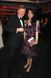 RENU MEHTA and SIR STEPHEN LAMPORT Private Secretary to the Prince of Wales 1996-2002 at the British Red Cross Gala Ball 2007 themed 'East Meets West' held at Old Billingsgate, 16 Lower Thames Street, London on 5th June 2007.<br /><br />NON EXCLUSIVE - WORLD RIGHTS