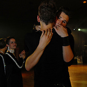 "World Champion same-sex ballroom dancers Robert Tristan Szelei, front left, and Gergely Darabos, front right, facing camera, hug as they listen to the announcement that they have won the standard division at the 2nd annual World Championship Same-Sex Ballroom Dancing competition, which was held their hometown, Budapest, Hungary, on October 21, 2006. ..Szelei and Darabos, who are known as the ""Black Swans,"" were the reigning world champions in men?s Latin same-sex ballroom dancing. They have been training and preparing to host the 2nd annual World Championship and the Csardas Cup, the first-ever Eastern European same-sex ballroom competition, both held at the Korcsarnok arena.  This is the pinnacle event of the blossoming same-sex ballroom scene...Szelei and Darabos were relieved to win the men?s Standard division after finishing a disappointing fourth in the Latin division. ..The event was organized by the US-based World Federation of Same-Sex Dancing, which hosted the first World Championship Same-Sex championships in 2005 in Sacramento, California. The Black Swans did a large amount of the coordination and planning in Budapest, a city that had never seen an event of this kind. When government funding fell through, they secured funding from patron Desire (accent on the ?e?) Dubounet, owner of the local Club Bohemian Alibi drag club. ..The World Championship events are newly recognized, but same-sex dancers have been competing on a national and international circuit for a number of years, especially in Europe, including at the Eurogames, the Gay Games, the London Pink Jukebox Trophy and the Berlin Open, among others. Countries including the United States, the Netherlands, Germany and, now, Hungary, hold their own national same-sex championships. Hungary held its first national championships in April 2006...Szelei and Darabos spent three months at the Sacramento Dancesport same-sex dance school in California this summer, on the first scholarship offered by the World"