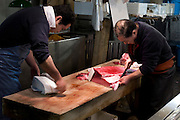 Slicing up tuna for sashimi. Tokyo Metropolitan Central Wholesale Market or Tsukiji Fish Market is the largest fish market in the world.