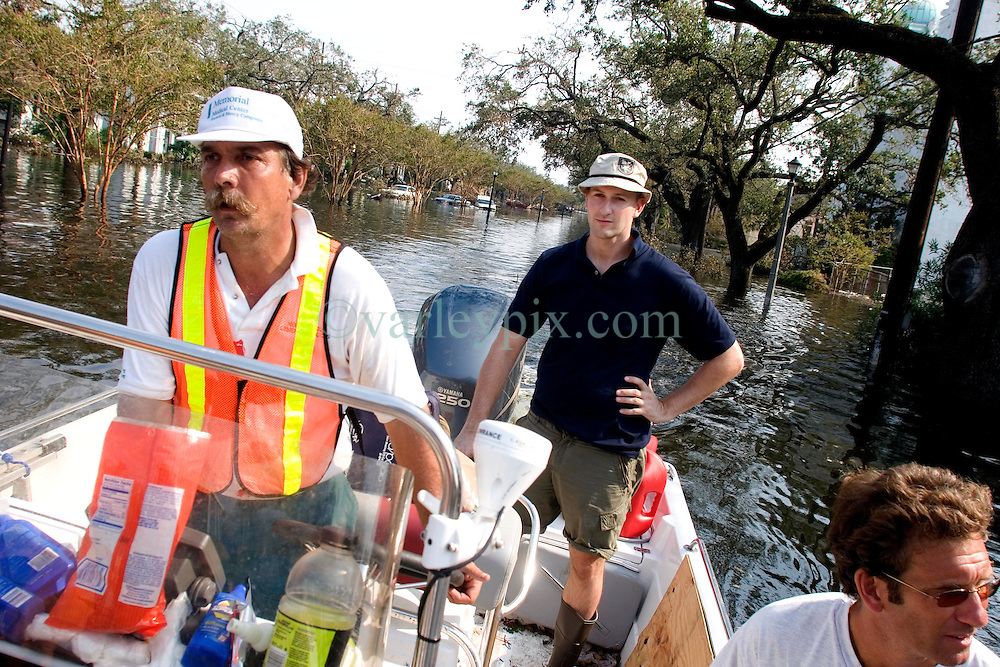 05 Sept  2005. New Orleans, Louisiana. Post hurricane Katrina.<br /> Animal rescue boat. Daily Mirror's Ryan Parry rides along in Jimmy Delery's boat on a rescue mission in Uptown New Orleans.<br /> Photo; ©Charlie Varley/varleypix.com