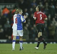 Photo: Aidan Ellis.<br /> Blackburn v Manchester United. Barclays Premiership. 01/02/2006.<br /> Blackburn's Robbie Savage applauds United's Rio Ferdinand after a mistake