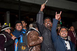 © Licensed to London News Pictures. 13/11/2015. London, UK. Pro Modi supporters taunt pro Kashmiri supporters outside Wembley Stadium after Indian Prime Minister Modi was special guest at a gathering for 55,000 British Indians inside the stadium. Photo credit : Stephen Chung/LNP