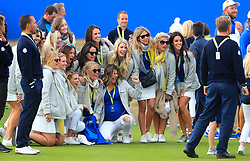 The wives and girlfriends of Team Europe celebrate on day three of the Ryder Cup at Le Golf National, Saint-Quentin-en-Yvelines, Paris.