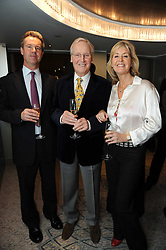 Centre, NICHOLAS PARSONS and his children JUSTIN PARSONS and SUZY BUCHANAN at the Lady Taverners Tribute Lunch in honour of Nicholas Parsons held at The Dorchester, Park Lane, London on 20th November 2009.