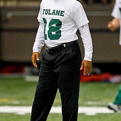 September 22, 2012; New Orleans, LA, USA; Tulane Green Wave head coach Curtis Johnson wears a t-shirt in support of injured player safety Devon Walker (18) for a game against the Ole Miss Rebels at the Mercedes-Benz Superdome. Walker suffered a fractured spine in the collision with a teammate during the first week of the season.  Mandatory Credit: Derick E. Hingle-US PRESSWIRE